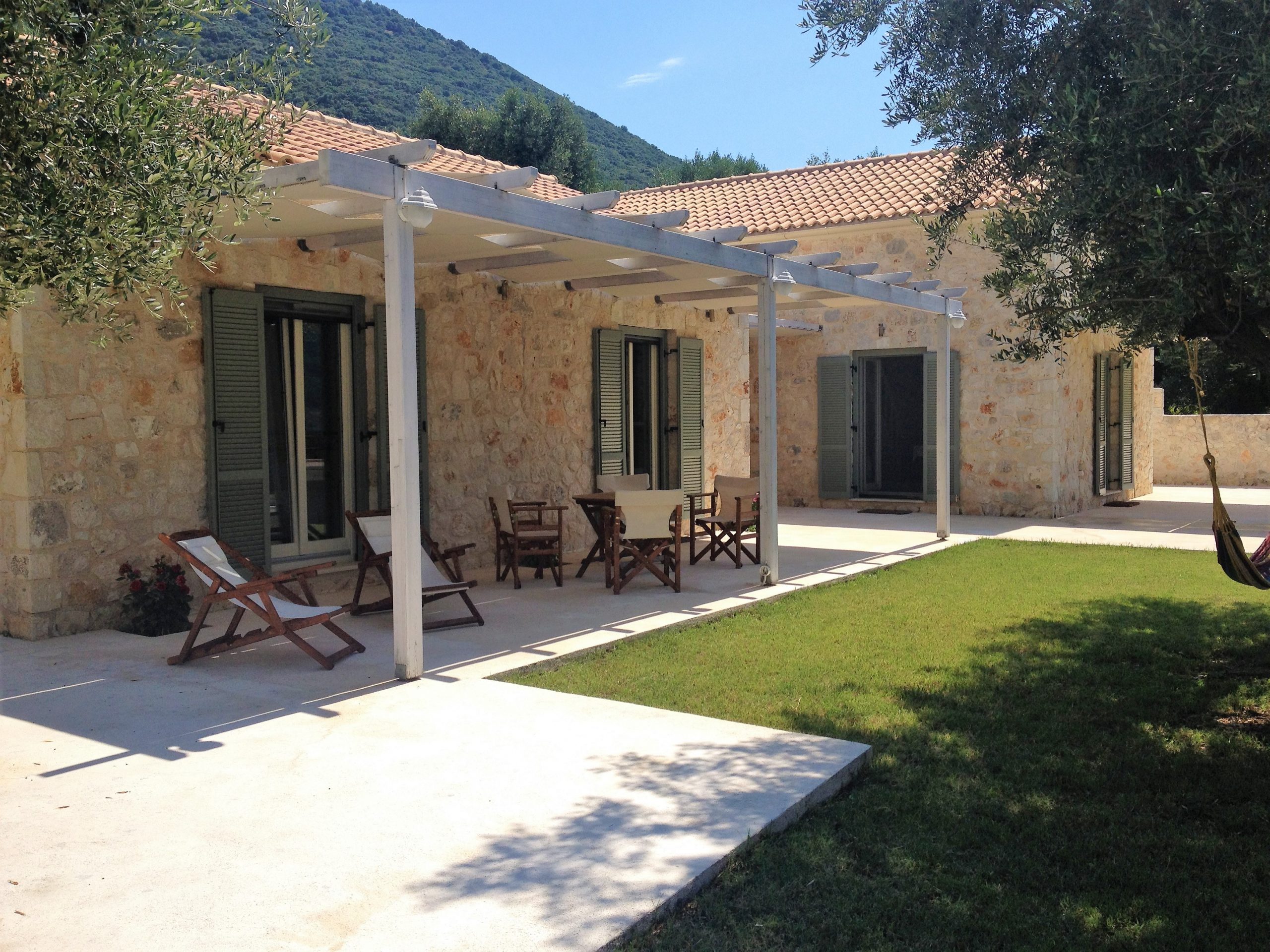 Stone facade of Kouvarata for rent MV Properties Ithaca Greece