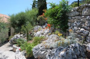 Stone rockery garden of house for sale Ithaca Greece