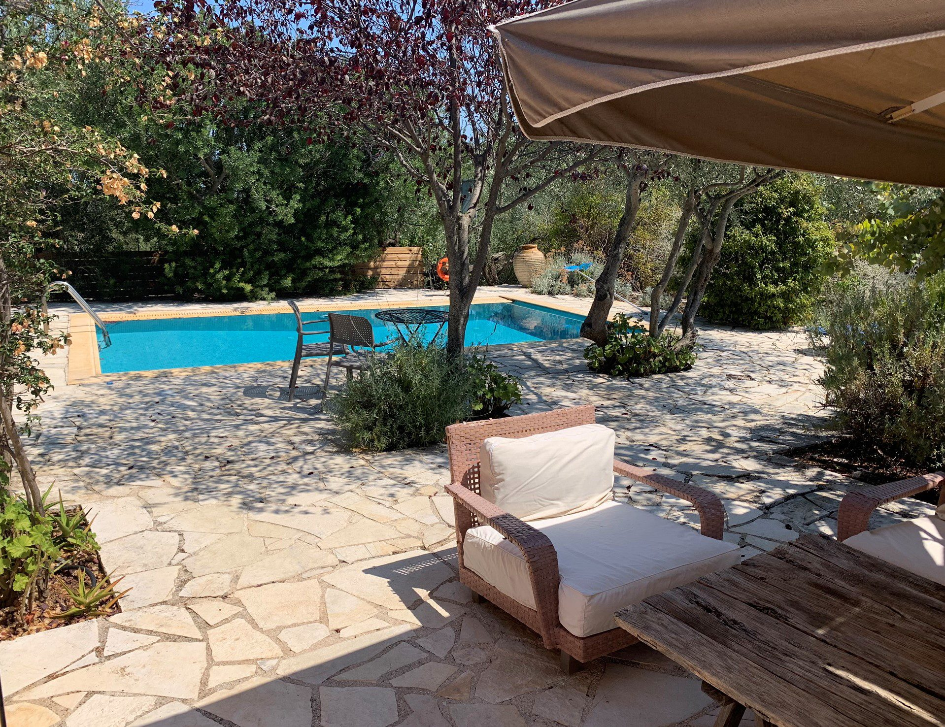 Outside terrace with swimming pool of house for sale in Ithaca Greece Vathi