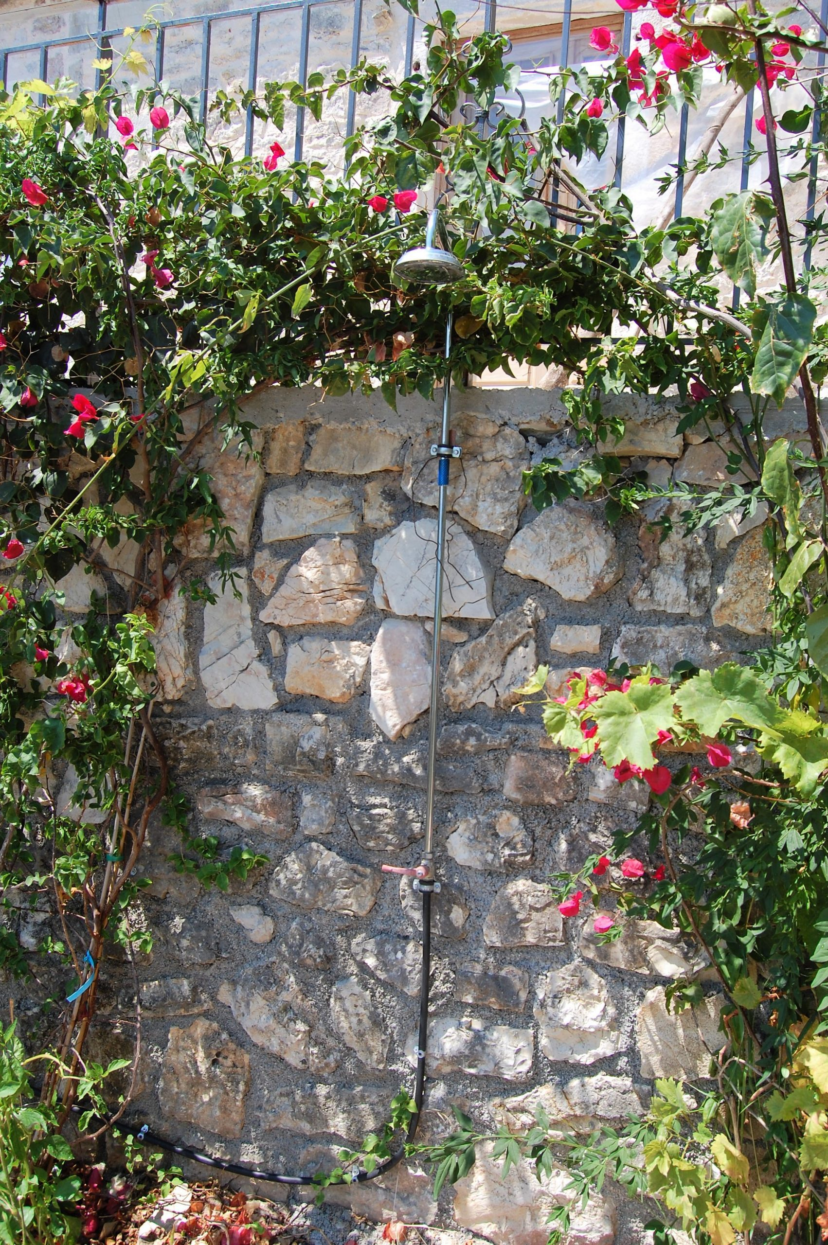 Outdoor shower of rental property in Kioni Ithaca Greece