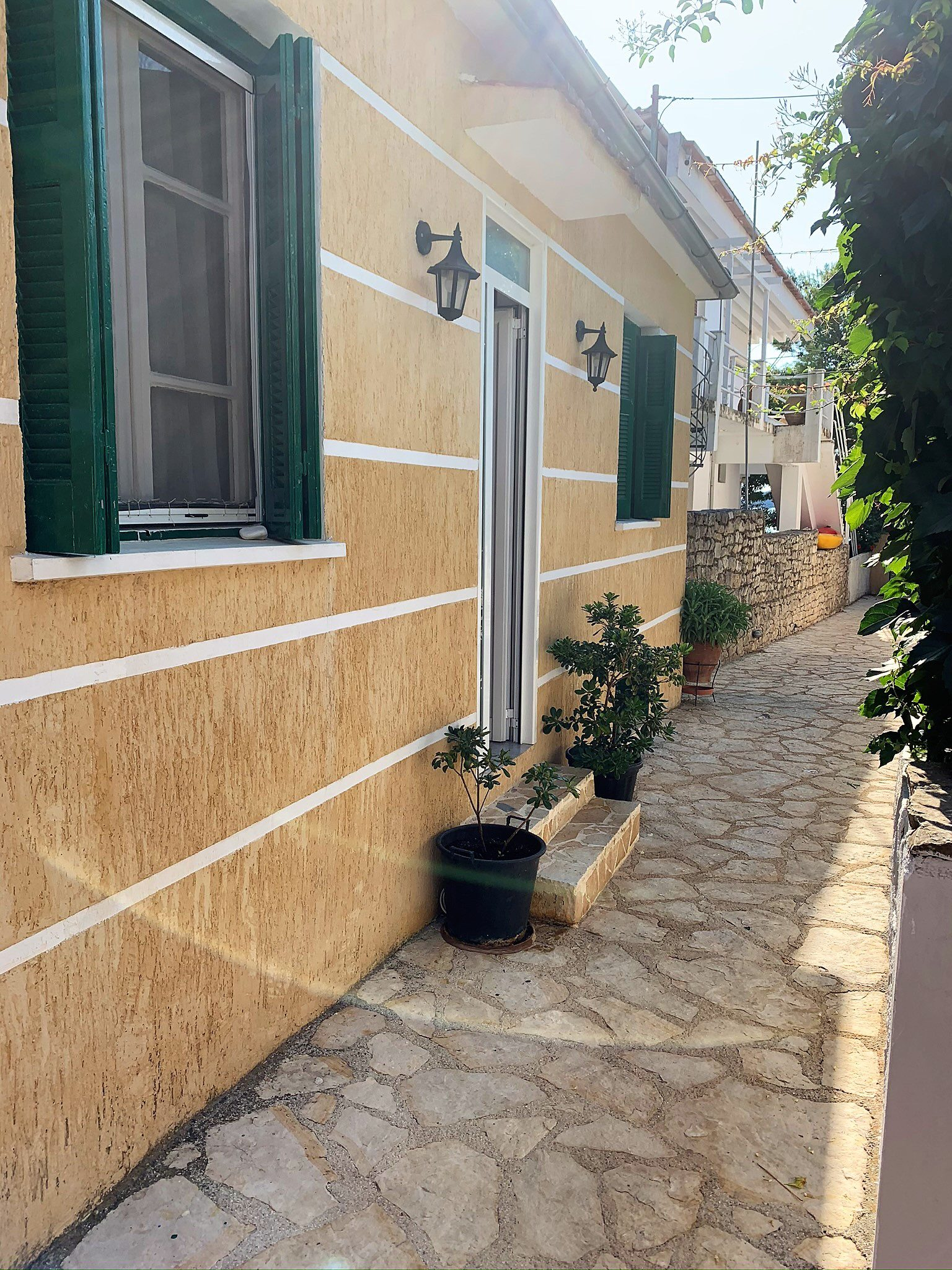 Exterior facade of house for sale on Ithaca Greece, Kioni