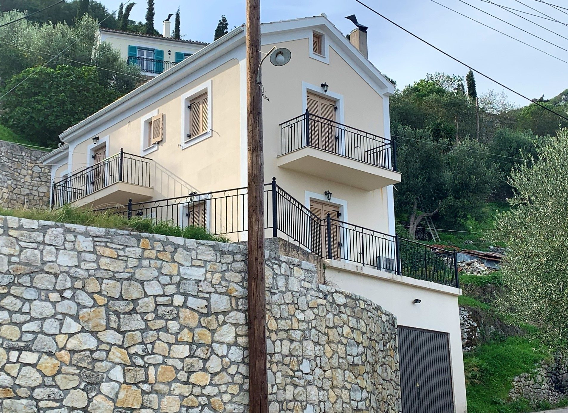 Exterior facade of house for sale in Ithaca Greece, Perachori